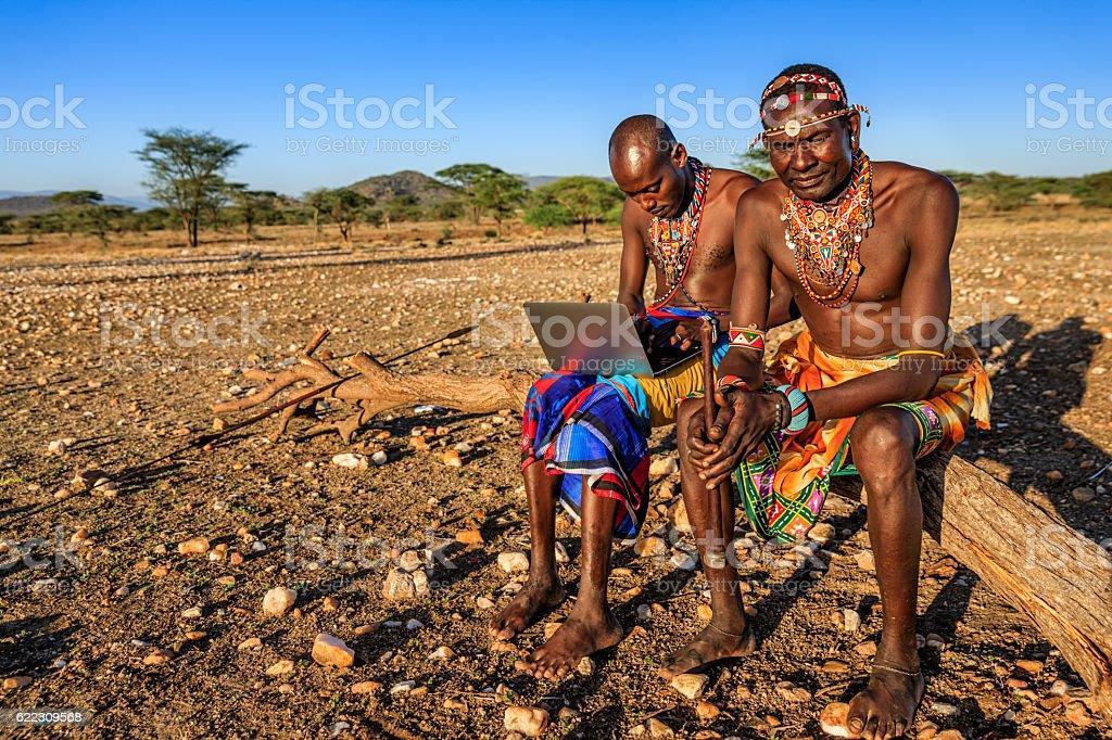 Warrior from Samburu tribe using laptop, Kenya, Africa – Foto