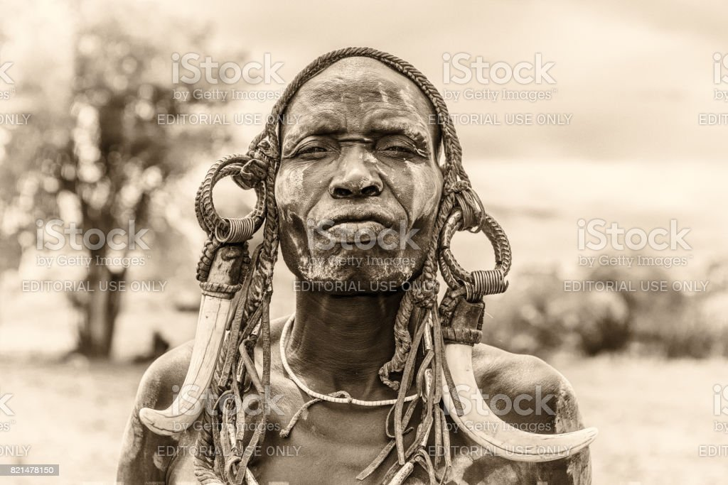 Warrior from the african tribe Mursi, Ethiopia stock photo