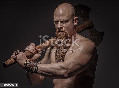 Weapon wielding warrior king alone in studio shoot