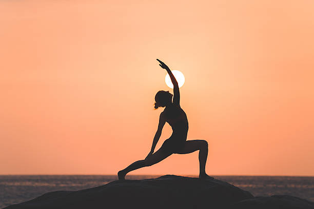 warrior pose from yoga - yoga stock photos and pictures