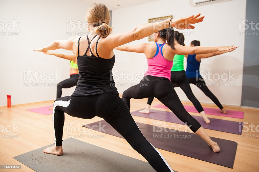 Warrior pose in yoga class stock photo