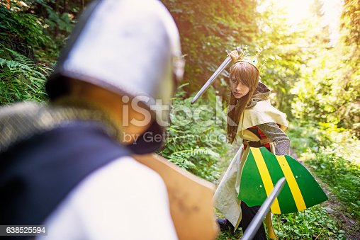 istock Warrior princess fighting with a knight 638525594
