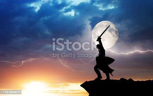 Warrior silhouette and lightning. Strength and power conceptual scene.