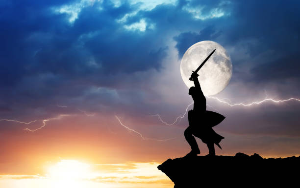 Warrior silhouette and lightning. stock photo