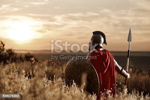 istock Warrior wearing iron helmet and red cloak. 838078352