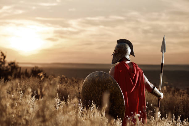 warrior wearing iron helmet and red cloak. - roman stock photos and pictures