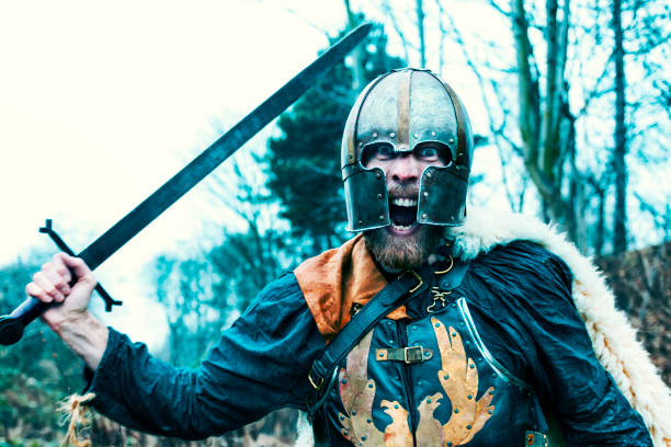 warrior with sword attacks and screams - battle stock photos and pictures