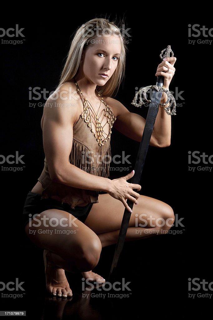 Warrior Woman Holding Sword stock photo
