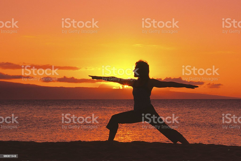 Warrior Yoga Pose in Sunset on Beach royalty-free stock photo