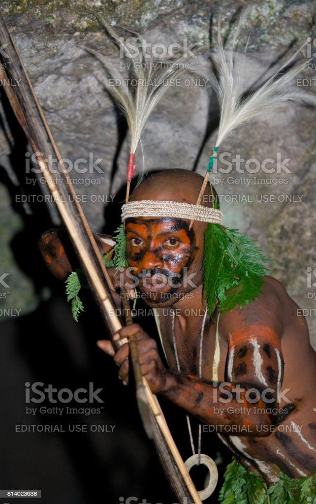 Warriors tribe Yaffi in war paint with bows and arrows in the cave. New Guinea Island, Indonesia. January 13, 2009. stock photo