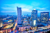 financial and residential buildings illuminated at dusk, Warsaw, Poland