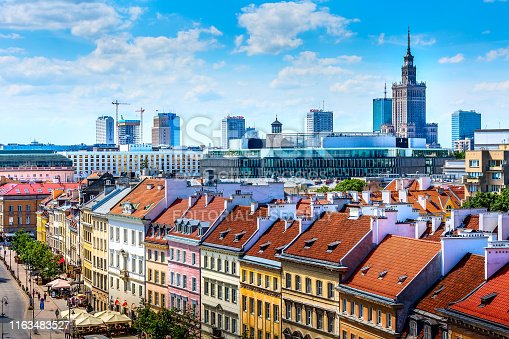 Warsaw, Poland - June 24, 2019: Modern skyscrapers and old colorful houses street view in Old Town of polish capital skyline aerial view