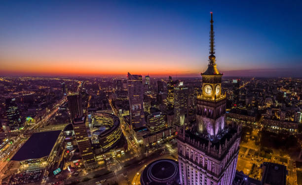 Warsaw city center and Warsaw skyscrapers at dusk aerial view stock photo