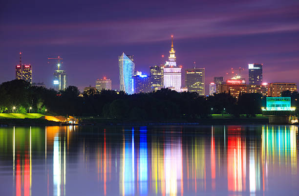 Warsaw night view of the city from the river stock photo