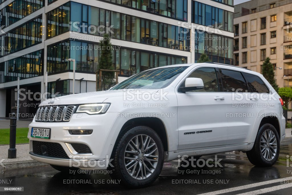 Warsaw, Poland April 2018: New SUV Jeep Grand Cherokee Model Against The  Background