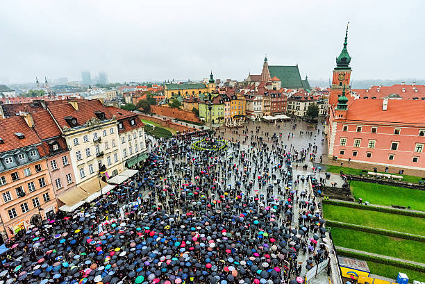 Warsaw protests in old town area Warsaw, Poland - October 4, 2016: View of people protesting for abortion rights in the old town area pro choice stock pictures, royalty-free photos & images