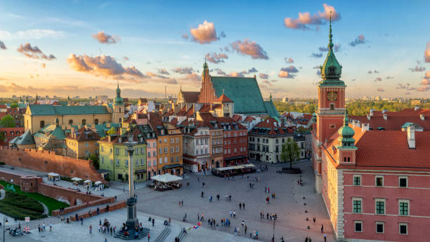 warsaw, royal castle and old town at sunset - poland stock photos and pictures