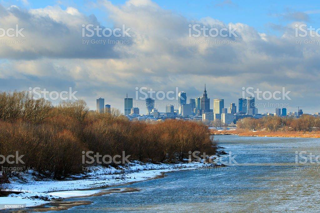 Warsaw sky line with skyscrapers, Vistula river shore in winter stock photo
