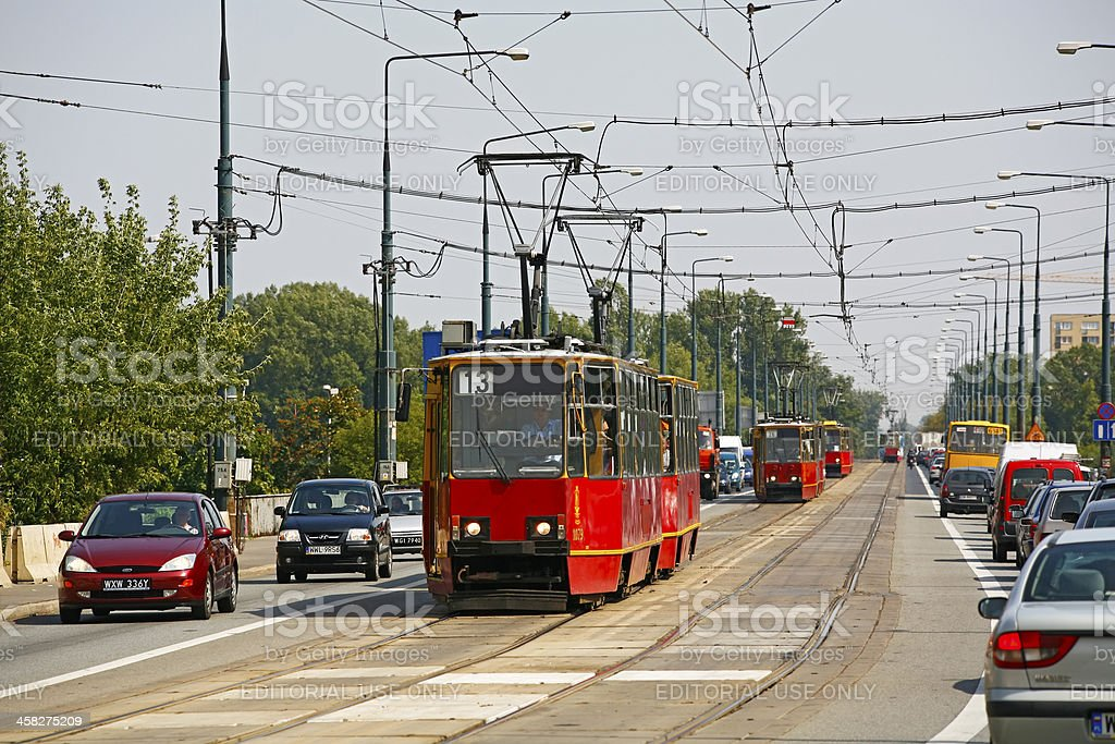 Warsaw trams and traffice on busy thoroughfare stock photo