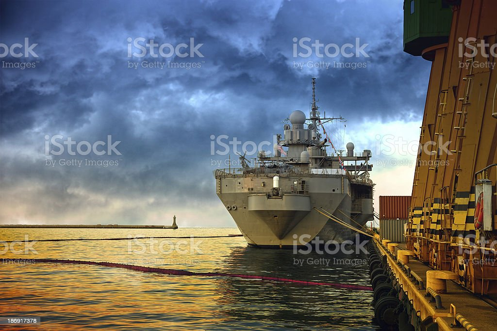 Warship in port stock photo