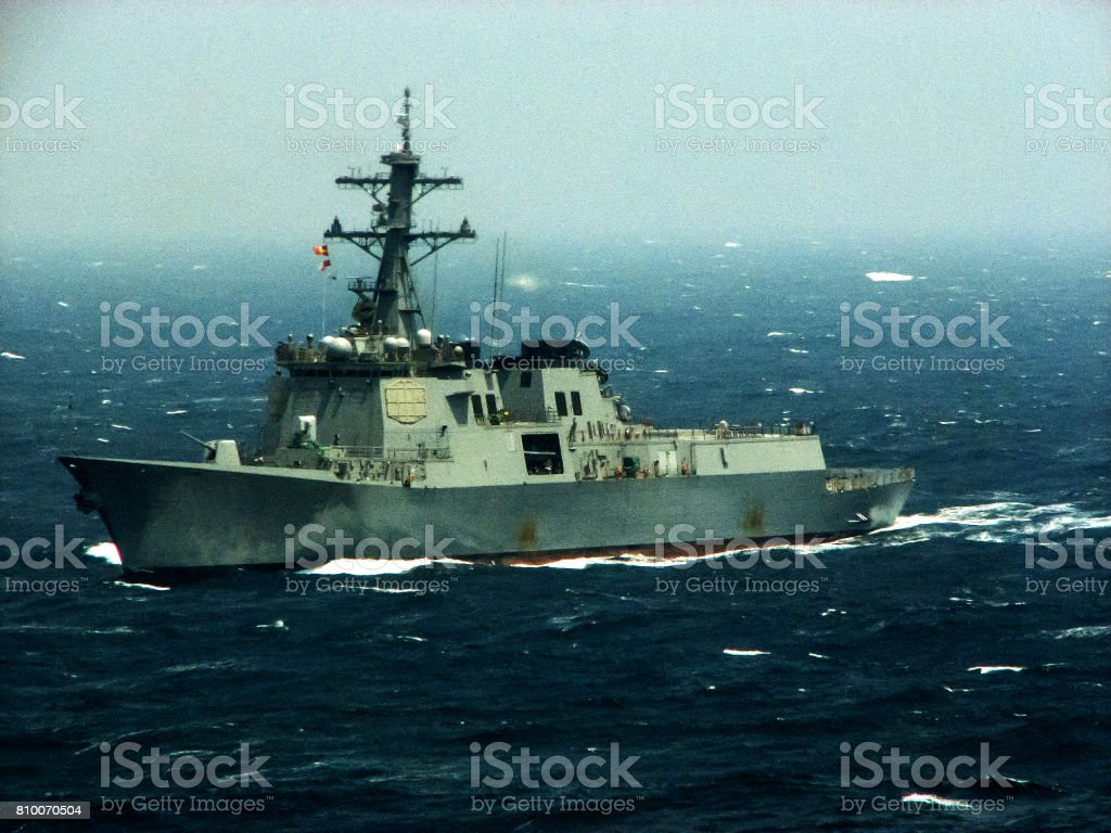 A warship in the sea. Battle ship at ocean stock photo