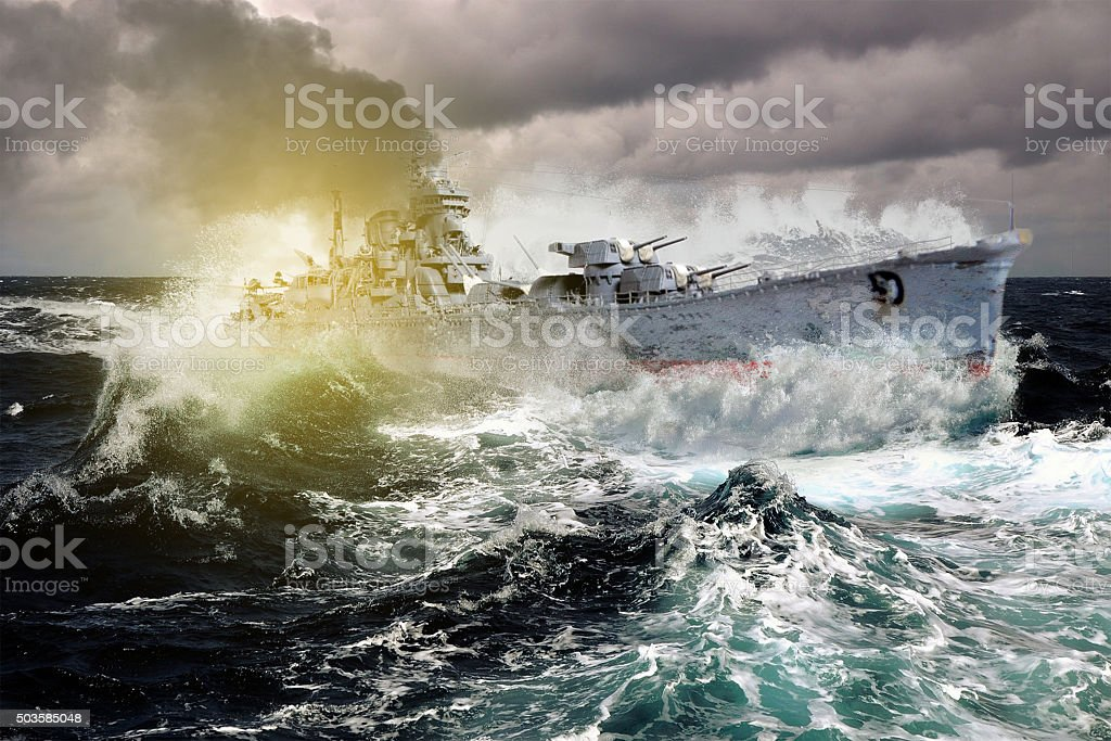 Warship sailing in a stormy sea stock photo