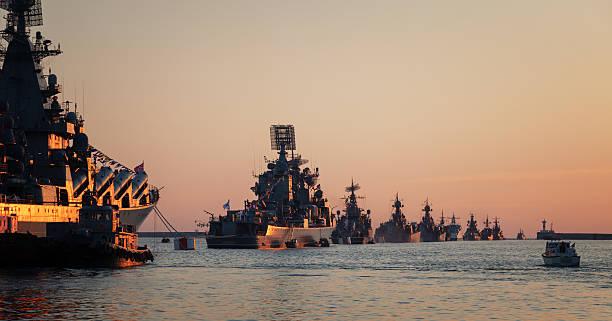 Warships in the wake ranks stock photo