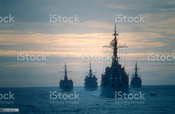 Four frigates doing an exercise on the ocean at the end of the day.I used a slide film