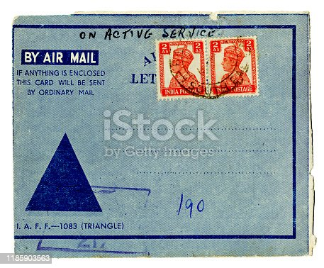 The front of an airmail letter sent from India during World War Two. The sender was 'On Active Service'. The postage stamps bear the portrait of King George VI, who was Emperor of India at the time. (Identifying details removed.)