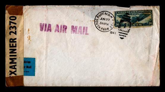 An envelope sent from Buffalo, NY, a few months before the USA entered World War Two. As it was sent to England, it has been opened and examined for security reasons then secured with a special label.