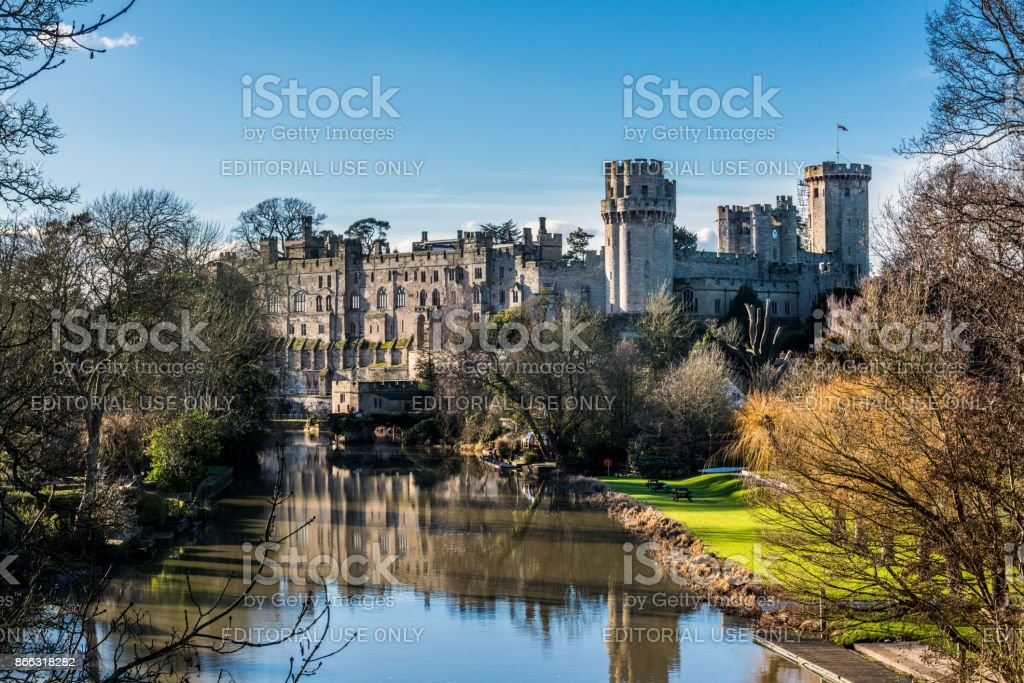 Warwick castle photographed on a sunny day in springtime with blue sky and copy space stock photo