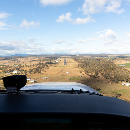 This image is of a Cessna 172S on final for Warwick runway 09. The photograph was taken on a private Cessna 172 on a navigation route. The Cessna 172 Skyhawk is an American four-seat, single-engine, high wing, fixed-wing aircraft made by the Cessna Aircraft Company. First flown in 1955, more 172s have been built than any other aircraft. It was developed from the 1948 Cessna 170, using tricycle undercarriage, rather than a tail-dragger. Warwick is a town and locality in southeast Queensland, Australia, lying 130 kilometres south-west of Brisbane. It is the administrative centre of the Southern Downs Region local government area.