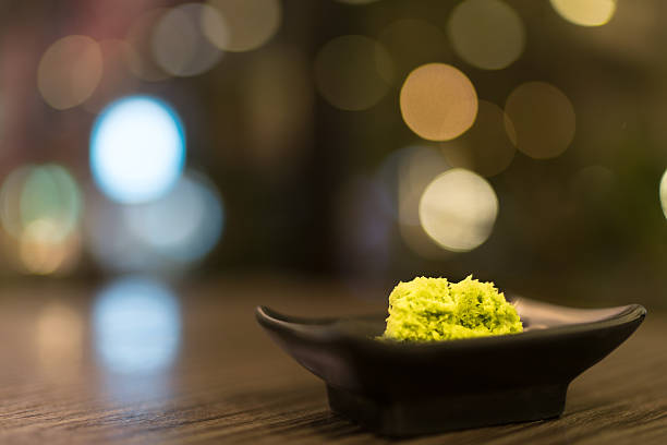 wasabi in black saucer, japanese food's condiment, bokeh background - わさび ストックフォトと画像