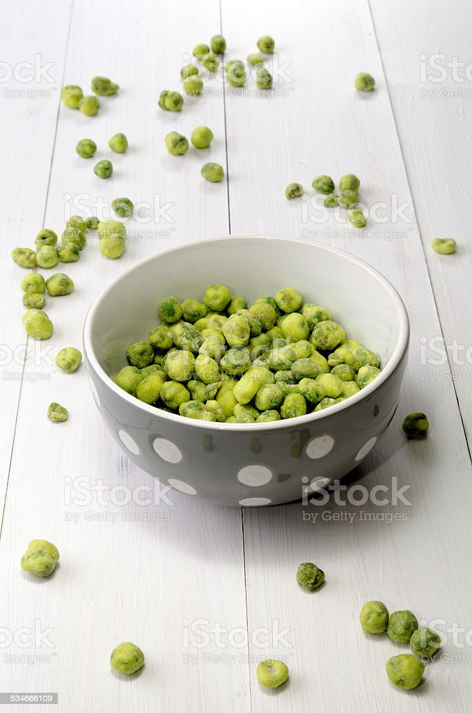 wasabi peas in a bowl stock photo