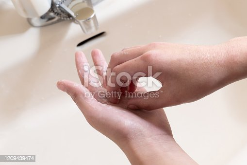 477282566 istock photo wash hands 1209439474