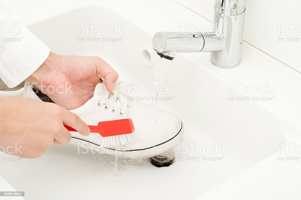 Wash shoes stock photo