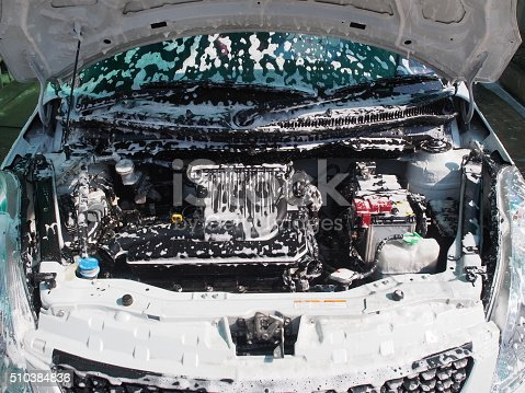 istock Wash the engine compartment car with foam. 510384836