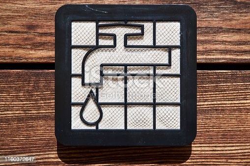 istock washable dir pollen hepa filter from vacuum cleaner with water tap icon on the wooden floor 1160372647