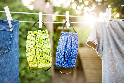 Washable facemask drying in sunlight