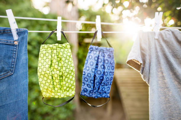 Washable facemask drying in sunlight stock photo