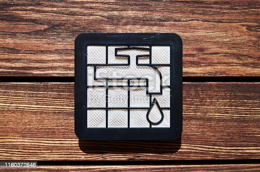 istock washable vacuum humidity hepa filter with water tap and drop icon on the wooden brown floor 1160372646