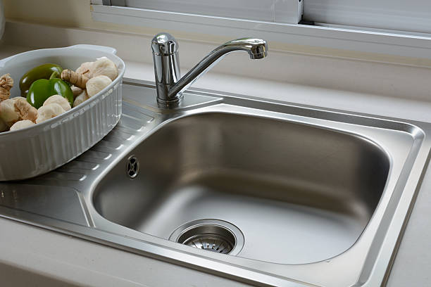 washbasin in a kitchen - kitchen sink stock photos and pictures