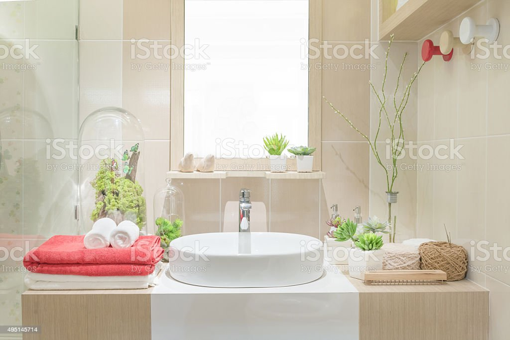 Washbasin with towel and decoration in bathroom stock photo