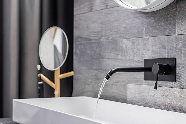 Washbasin with wall mounted tap stock photo