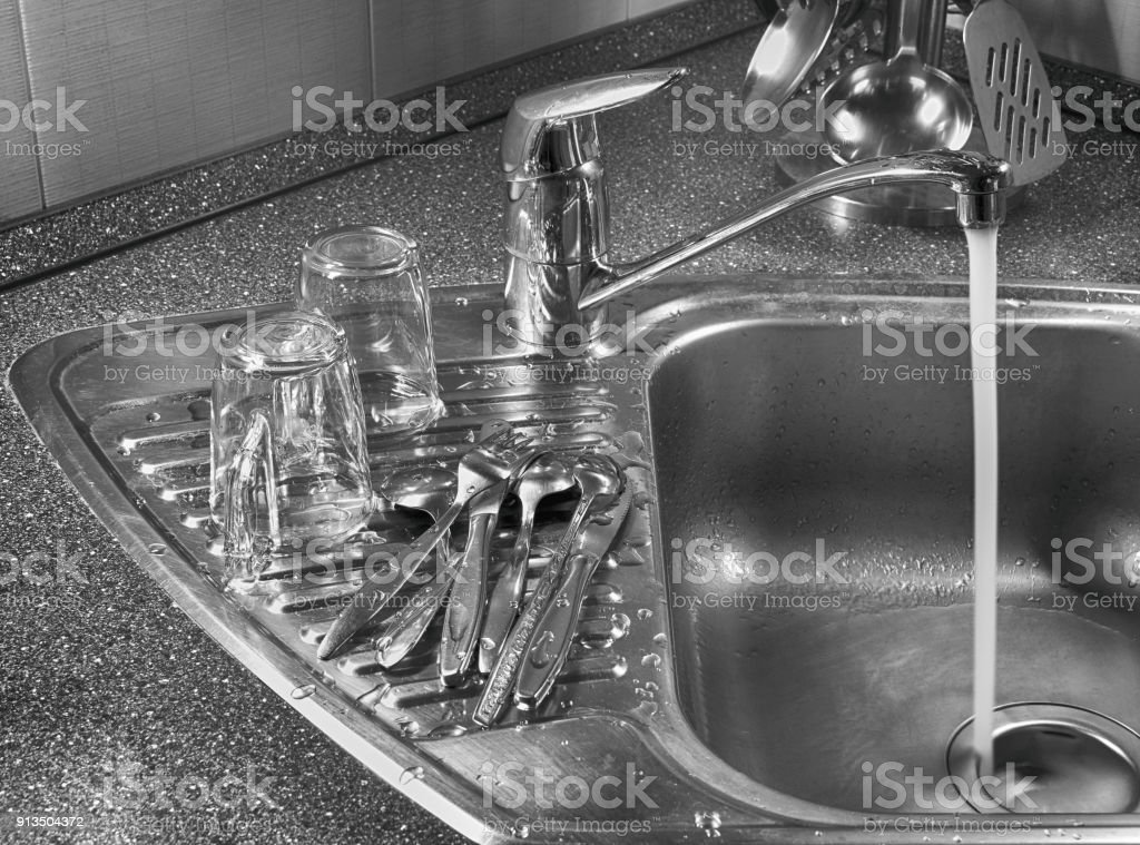 Washed Appliances And Cups On The Table Near The Kitchen ...