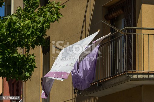 istock Washed clothes and hanged for drying 824750378