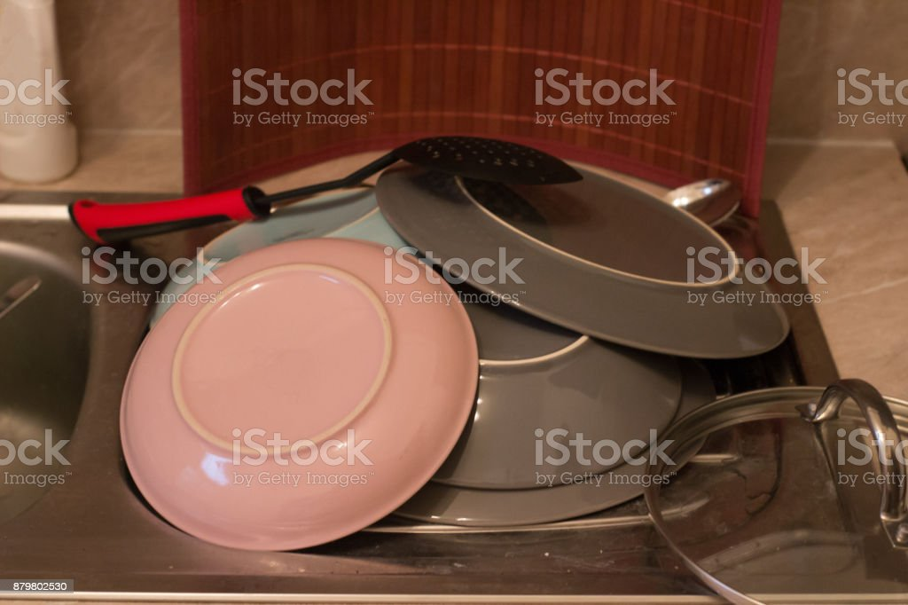 washed dishes and plates and spoons stock photo