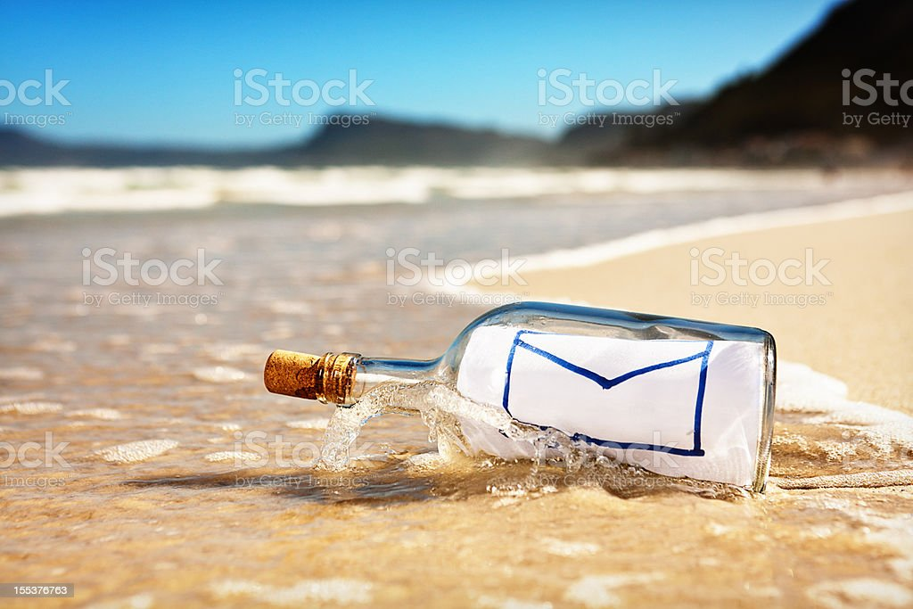 Washed up bottle with message showing icon for email stock photo