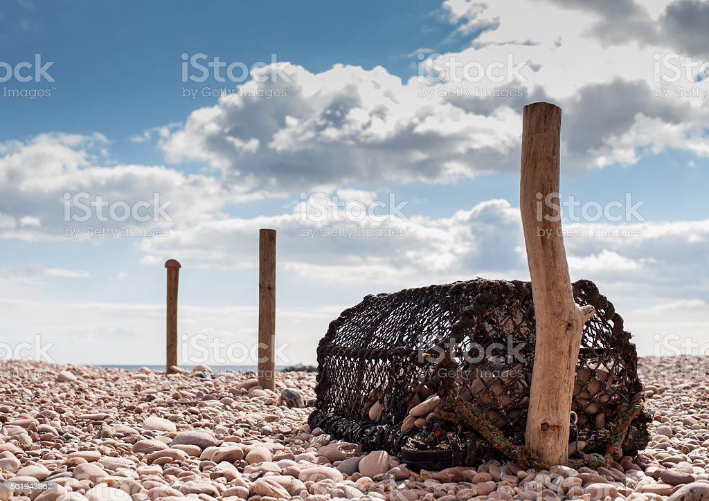 Washed up lobster pot stock photo