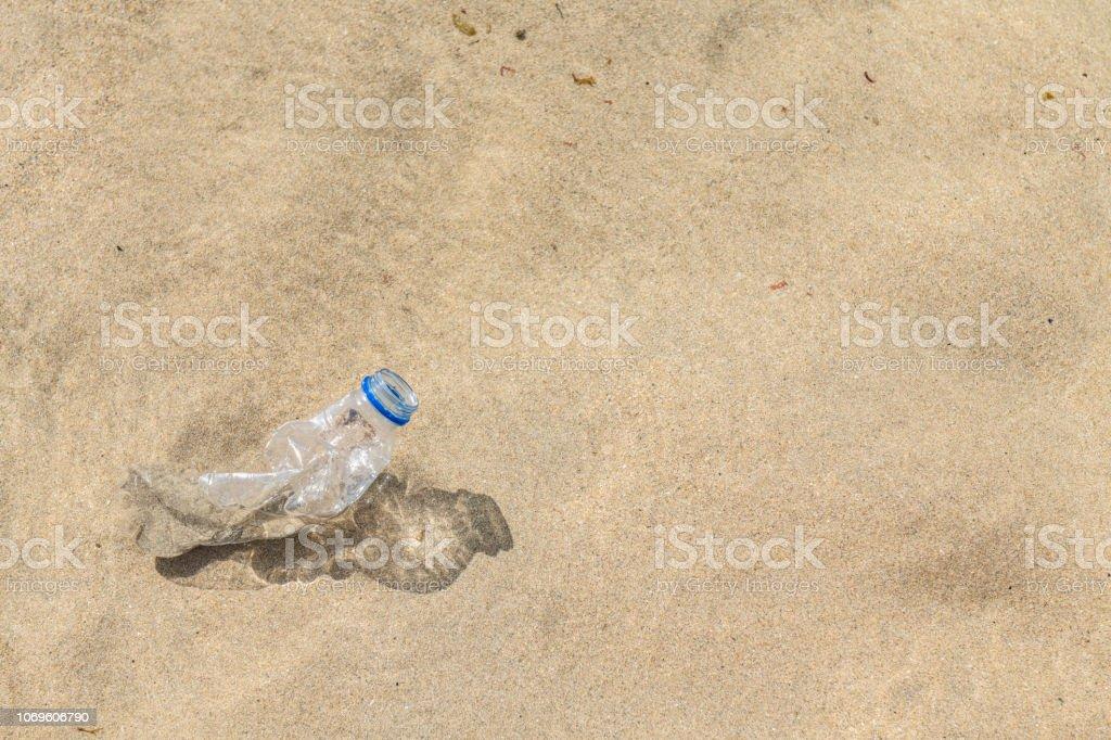Washed up Plastic Bottle at the coast. stock photo